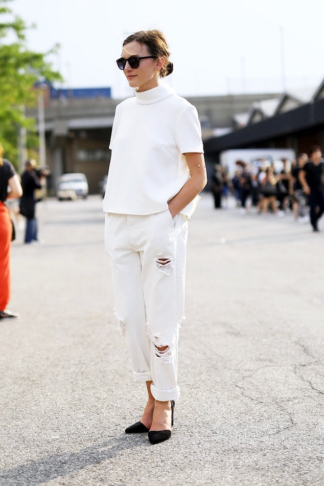Le-Fashion-Blog-NYC-Street-Style-Low-Bun-Sunglasses-White-On-White-Top-Ripped-Boyfriend-Jeans-Black-Heels-Via-Popsugar