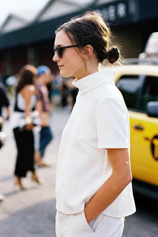 Le-Fashion-Blog-NYC-Street-Style-White-On-White-Low-Bun-Chignon-Mock-Neck-Top-Boyfriend-Jeans-Via-Vanessa-Jackman