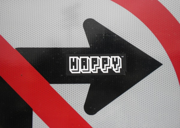 street-art-happy-on-sign